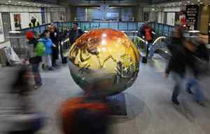 People walk past an art installation as they leave a metro station in Copenhagen on December 15, 2009.