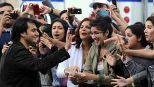 Indian actor Arbaaz Khan acknowledges fans during a green carpet event on June 24, 2011 ahead of the 2011 International Indian Film Academy (IIFA) awards in Toronto.