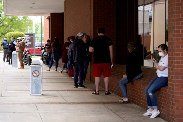 Almost 4 million more Americans file for unemployment