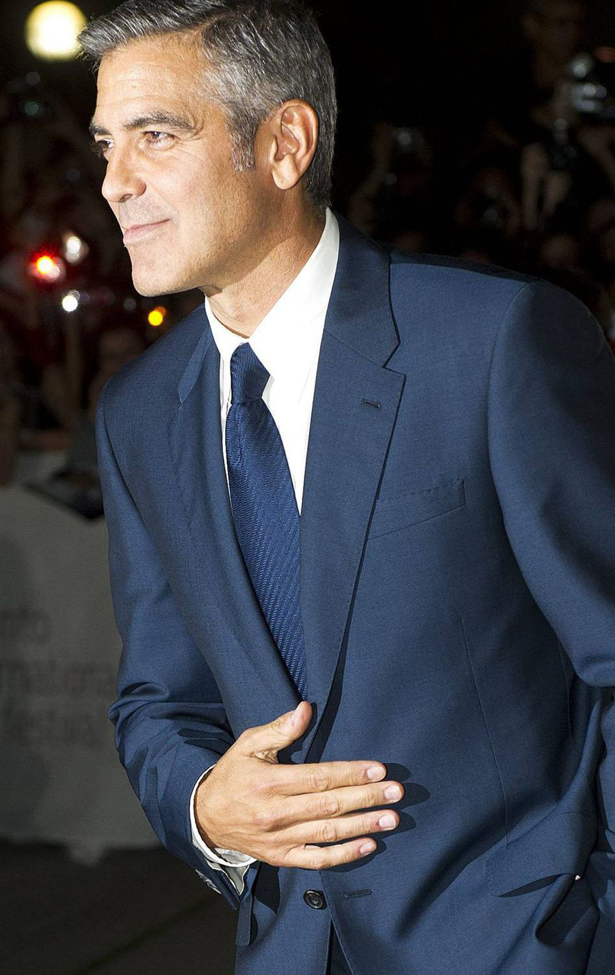 "George Clooney poses on the red carpet before the screening of ""The Ides of March"" at the Toronto International Film Festival on Friday, Sept., 9, 2011. THE CANADIAN PRESS/Nathan Denette"