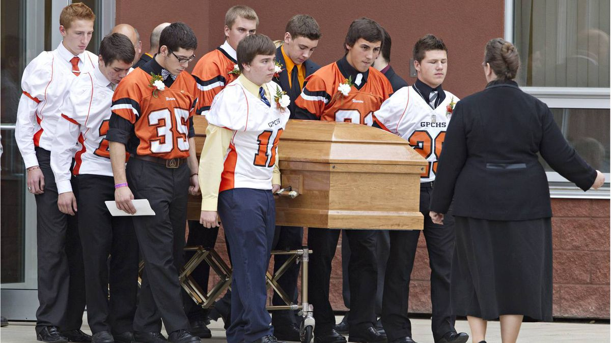 Teammates of Vince Stover 16, carry his casket after the funeral in Grande Prairie Oct. 28, 2011. Vincent Stover 16, was killed in a car accident along with Matt Deller, 16, Walter Borden - Wilkins age 15 and Tanner Hildebrand, 15, in Grand Prairie on Saturday, Oct. 22, 2011.