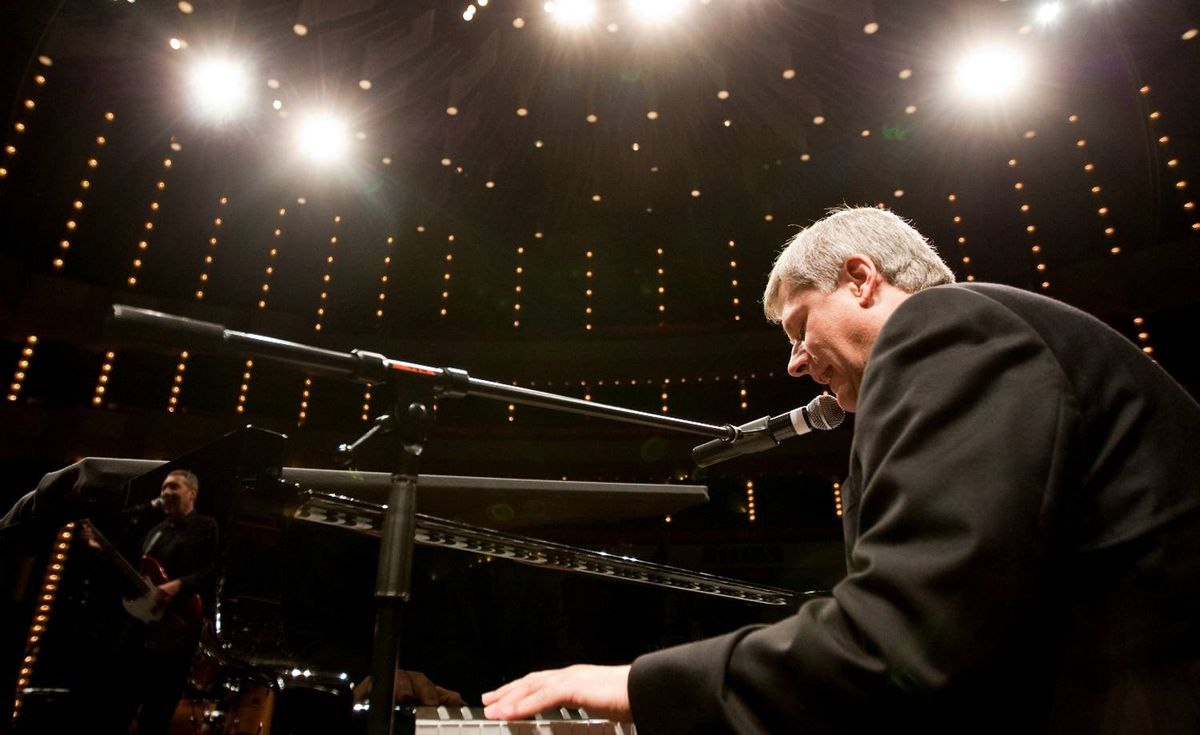 """This photo was distributed Oct. 3 by the Prime Minister's Office shortly after Mr. Harper finished his famous piano rendition of With a Little Help from My Friends at the National Arts Centre Gala. It was erroneously captioned: """"Prime Minister Stephen Harper performs """"With A Little Help From My Friends"""" at the 2009 National Arts Centre Gala."""" In fact, the photo had been taken by a PMO photographer hours earlier during a private rehearsal. The caption was not corrected."""