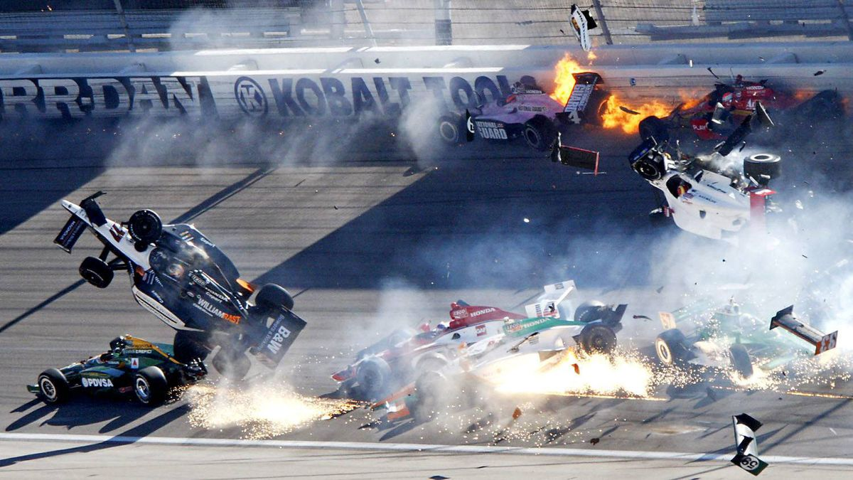 Drivers, including Dan Wheldon (77, in air at left), crash during a wreck that involved 15 cars during the IndyCar Series' Las Vegas Indy 300 auto race at Las Vegas Motor Speedway in Las Vegas on Sunday, Oct. 16, 2011. Wheldon died following the crash.