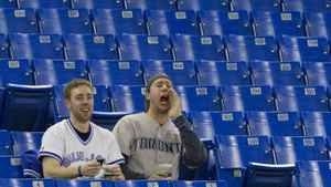 Toronto Blue Jays fans yell while sitting amongst empty seats at the Rogers Centre during MLB baseball action between the Blue Jays and the Oakland Athletics in Toronto Wednesday, April 6, 2011.
