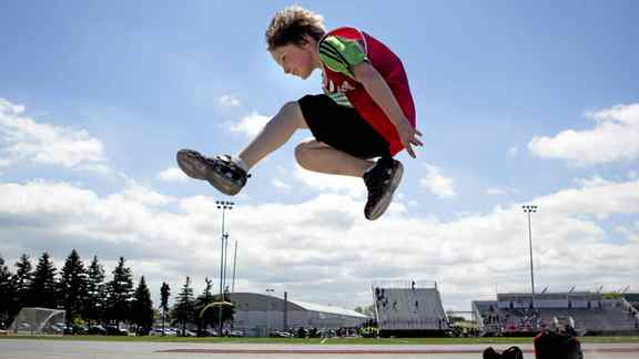 Nathaniel Hobdon, a Grade 4 student at Norway Junior Public School in Toronto, practises his long jump as he competes in a track and field qualifying day on May 24, 2011.