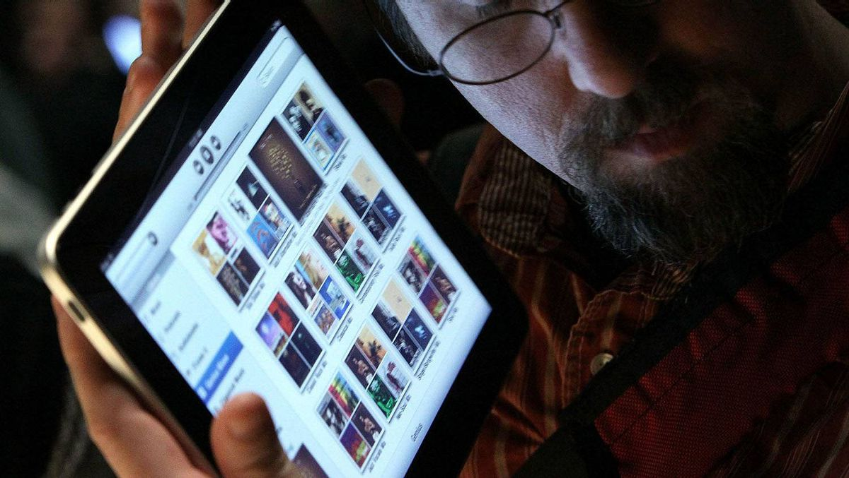 An event guest plays with the new Apple iPad during an Apple Special Event in San Francisco on Jan. 27, 2010.