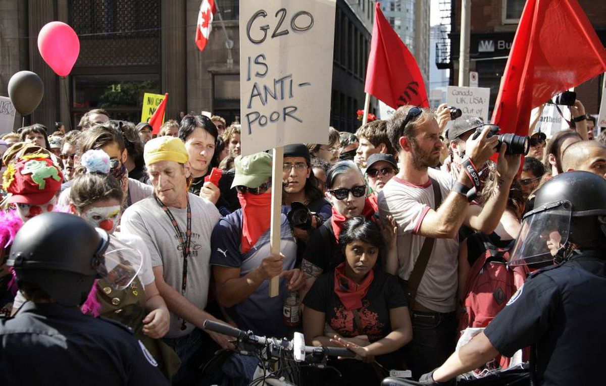 Activists march along the streets of downtown Toronto while participating in a protest ahead of the G20 summit.