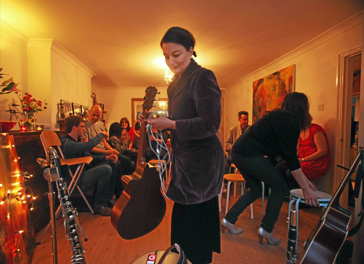 Jane Siberry performs for a small audience in a private home in London.