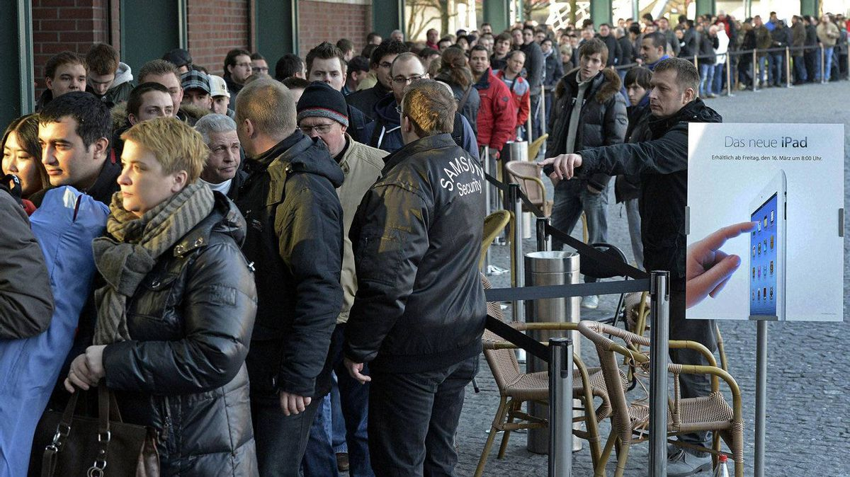Hundreds of people line up in front of a shopping mall in Oberhausen, western Germany, to buy the new iPad at the Apple store, Friday, March 16, 2012.