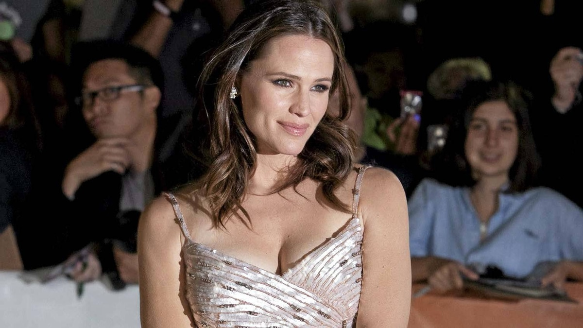"Actress Jennifer Garner poses at the gala for the film ""Butter"" during the Toronto International Film Festival in Toronto Tuesday, September 13, 2011."