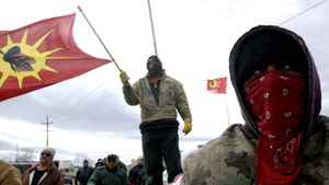 Native protesters stand at a housing development near Caledonia, Ont., despite a court order asking them to leave, on March 22, 2006.