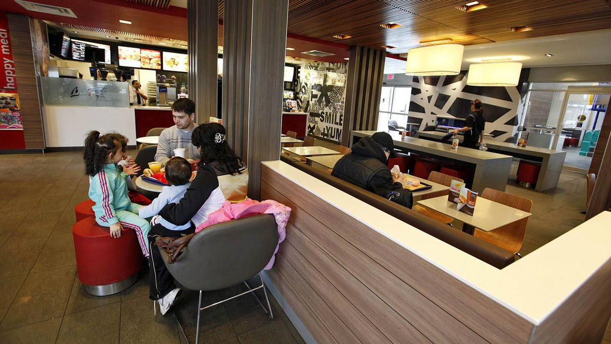 The Horvath family has lunch at the newly built McDonald's location at St. Clair Avenue East and Victoria Park Avenue in Toronto. The restaurant has modern style seating, designs on the walls, flat screen televisions and a fireplace.