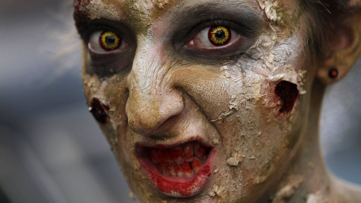This Thursday, Sept. 22, 2011 photo shows an actor in costume and makeup as she poses in her setting at the House of Shock, a haunted house, in New Orleans.
