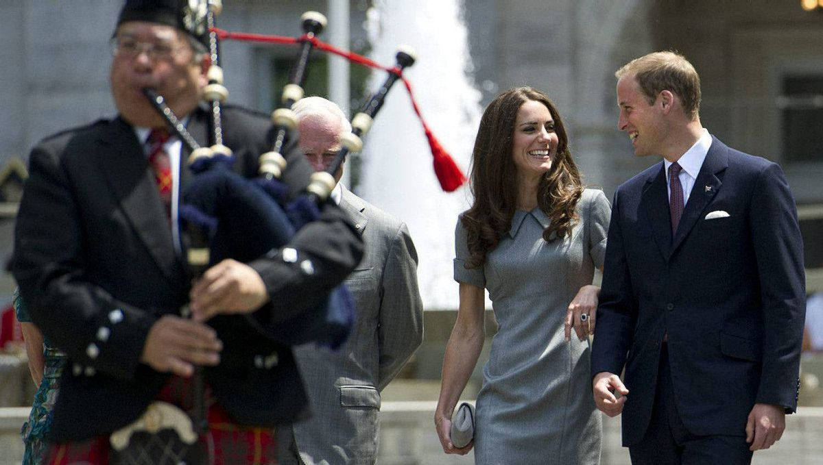 The Duke and Duchess of Cambridge walk behind a bagpiper as they arrive for a ceremonial tree planting accompanied Governor General David Johnston at Rideau Hall in Ottawa on Saturday, July 2, 2011.