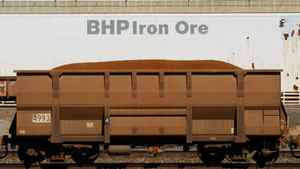 An iron ore train car enters BHP Billiton's loading facility in Port Hedland, Australia. Iron ore made up half of BHP's earnings, with underlying profit from the core ingredient in steel rising 36 per cent to $7.9-billion.