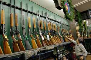 Hunting rifles and shotguns sit on the racks at a Toronto gun shop in December of 2002.