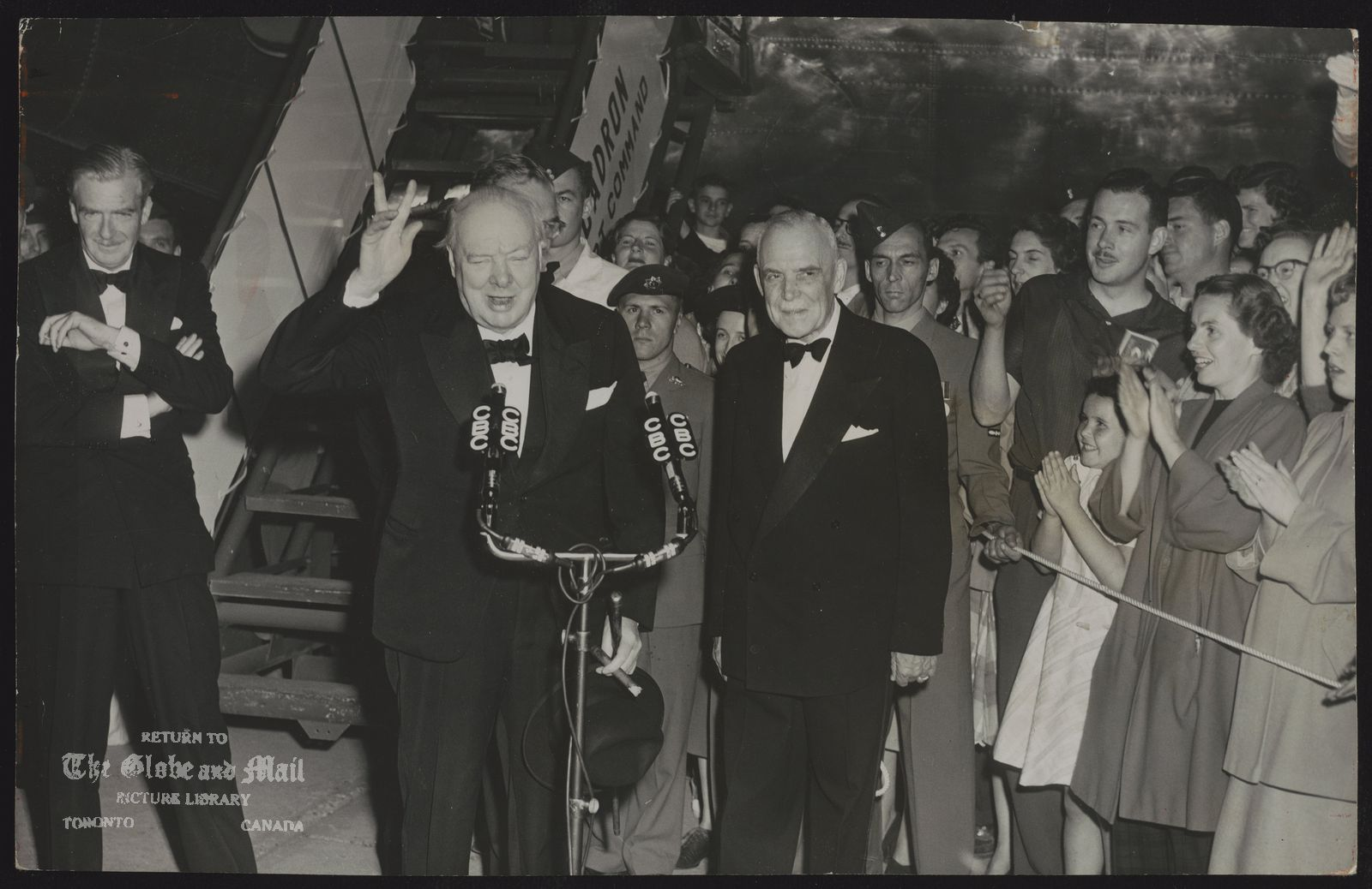 Winston CHURCHILL In Ottawa Farewell to visiting British statesman brought large crowds to airport at Ottawa Wednesday night when Prime Minister Churchill spoke briefly, gave his famous