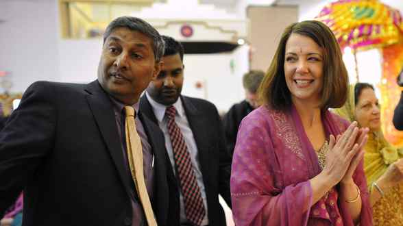 Leader of the Wildrose Party Danielle Smith (R) and Wildrose MLA Prasad Panda meet with members of the Hindu community during a campaign stop at a Hindu Temple in Calgary, Alberta, April 15, 2012.