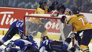 Shawinigan Cataractes Michael Bournival, right, and Anton Zlobin celebrate their first goal as Saint John Sea Dogs goalie Mathieu Corbeil and Kevin Gagne dive into the net during second period Memorial Cup action in Shawinigan Que., on Wednesday, May 23, 2012.