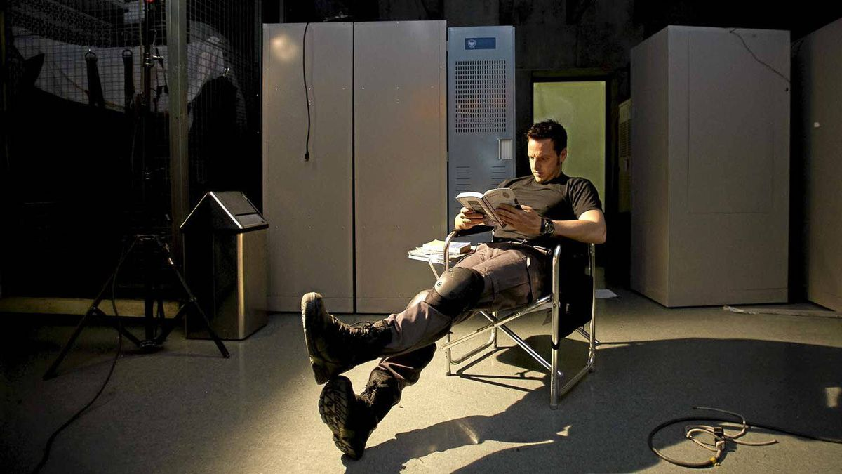 """Actor Sergio Di Zio reads on the set of """"Flashpoint"""" in Toronto."""