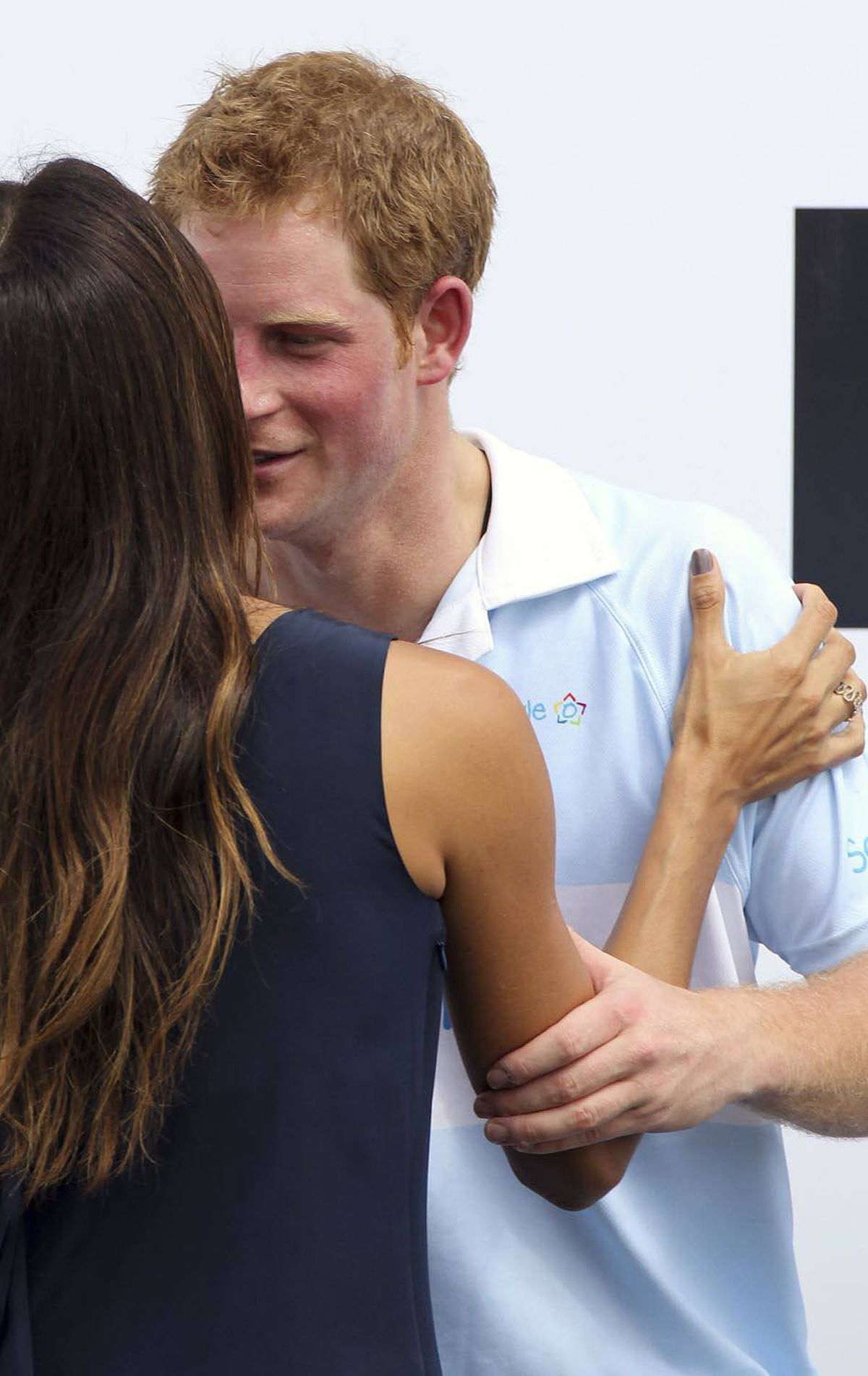 LADIES MAN Britain's Prince Harry speaks to Brazilian model Fernanda Motta after playing a polo match at a farm in Campinas, Brazil, March 11, 2012.