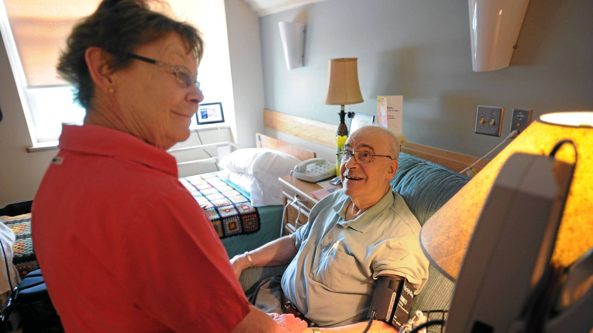 Registered nurse Cheri Morren gives eighty-four-year-old Harold Sacks a check-up in his room at St. Joseph's Villa in Dundas, Ont. June 17/2011.