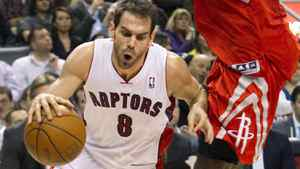 Toronto Raptors' Jose Calderon drives to the basket in the first half against the Houston Rockets in Toronto, March 7, 2012.