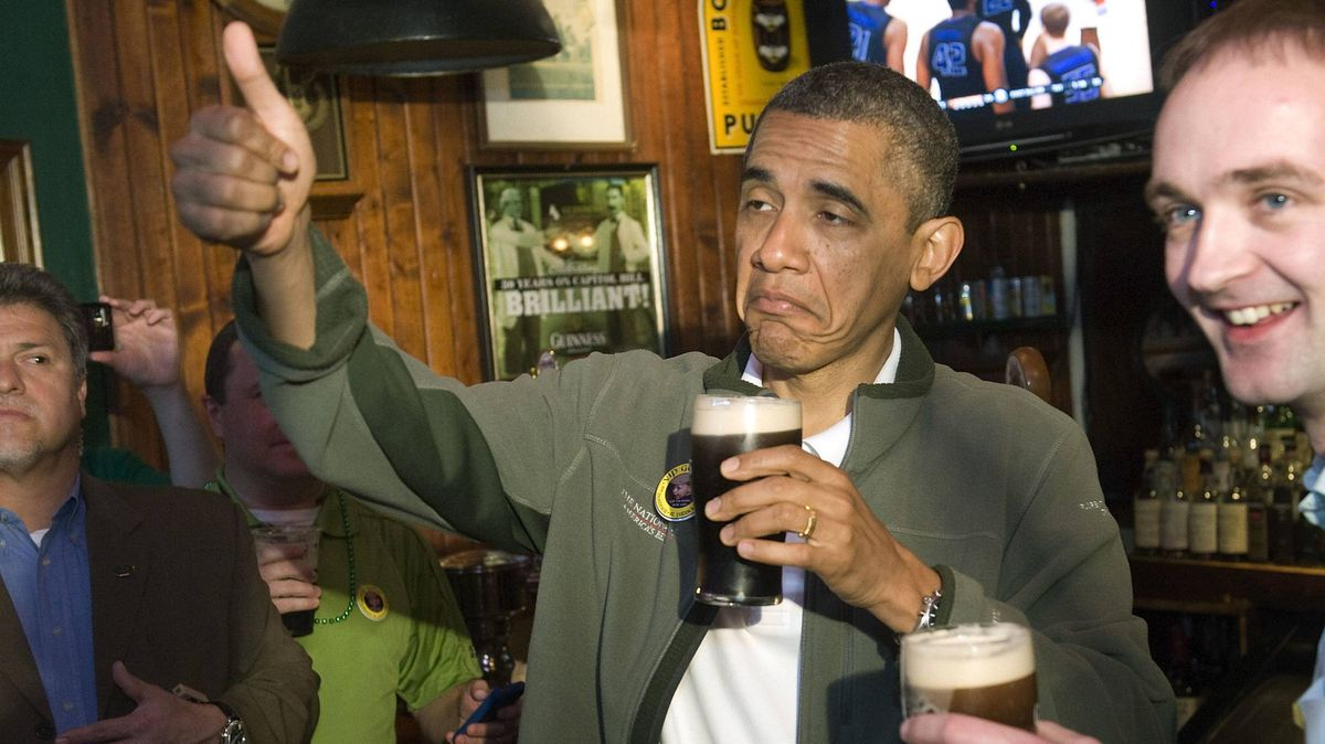 U.S. President Barack Obama shows his approval as he celebrates St. Patrick's Day with a Guinness at the Dubliner Irish pub in Washington.