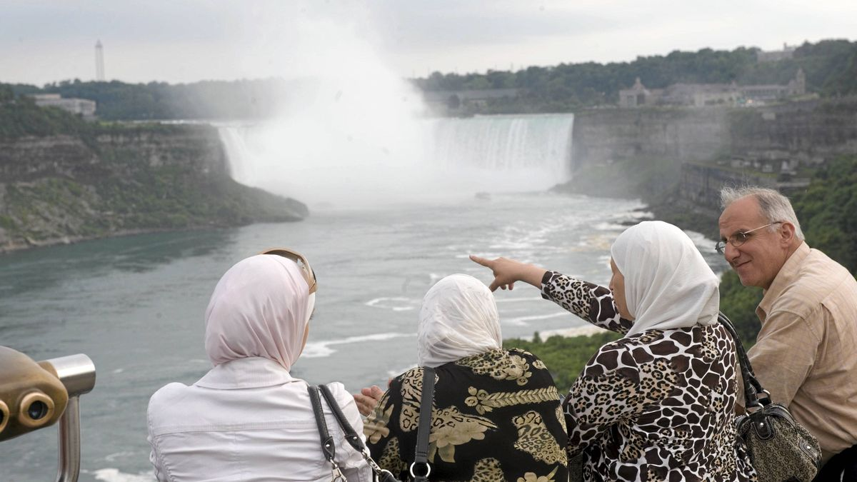 Crowds of tourists are photographed at the falls in Niagara Falls, Ont. July 30/2009.