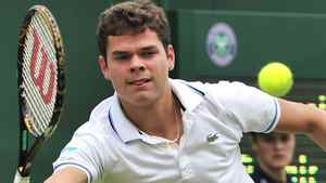 Canadian player Milos Raonic returns the ball to French Marc Gicquel during the Wimbledon Tennis Championships at the All England Tennis Club, in southwest London on June 20, 2011. Getty Images / GLYN KIRK