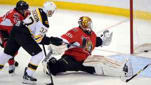 Ottawa Senators' Alex Auld, right, looks back into the net as Boston Bruins' Patrice Bergeron, centre, scores a goal as Senators' Erik Karlsson defends during first period NHL hockey action at the Scotiabank Place in Ottawa on Saturday, Feb. 25, 2011. THE CANADIAN PRESS/Sean Kilpatrick