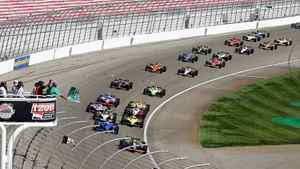 Drivers take the green flag to begin the IndyCar Series' Las Vegas Indy 300 auto race on Sunday, Oct. 16, 2011, in Las Vegas.