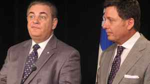Jacques Duchesneau (left), the head of Quebec's anti-collusion unit, and QuebecTransport Minister Pierre Moreau meet reporters Friday Sept. 23, 2011 in Montreal.
