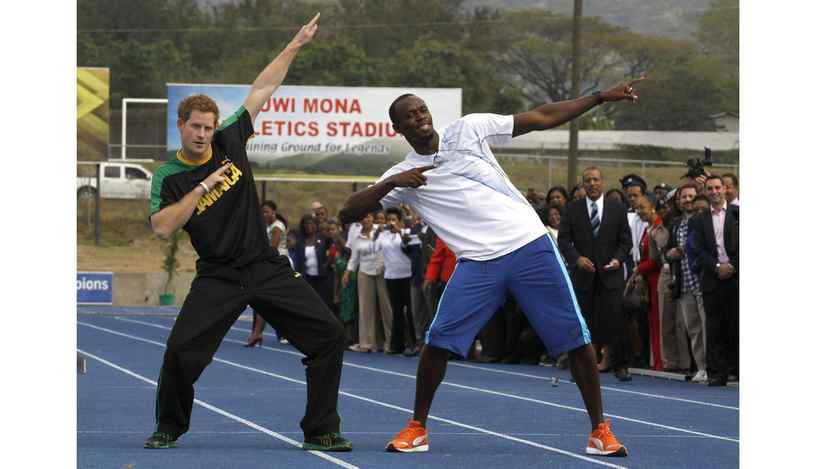 "Prince Harry and Olympic gold medallist Usain Bolt pose at the Usain Bolt track at the University of the West Indies in Kingston on March 6, 2012. The pair ""raced,"" with the Prince crossing the finish line first."
