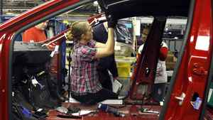 In this Feb. 2, 2012 photo, an auto worker assembles parts on the 2013 Dodge Dart at the Chrysler Plant in Belvidere, Ill. Sergio Marchionne, Chairman and CEO Chrysler Group, announced that Chrysler will add a third shift at the Belvidere Plant to begin production of the Dart. The number of available jobs jumped in December, nearly matching a three-year high reached last fall, a hopeful sign that January's large job gain may continue. (AP Photo/Charles Rex Arbogast)