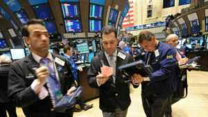Traders work on the floor of the New York Stock Exchange (NYSE) November 23, 2010 after the opening bell. US stocks fell Tuesday as traders fretted over a spike in tensions in the Korean peninsula and turmoil in Ireland after its bailout plan.