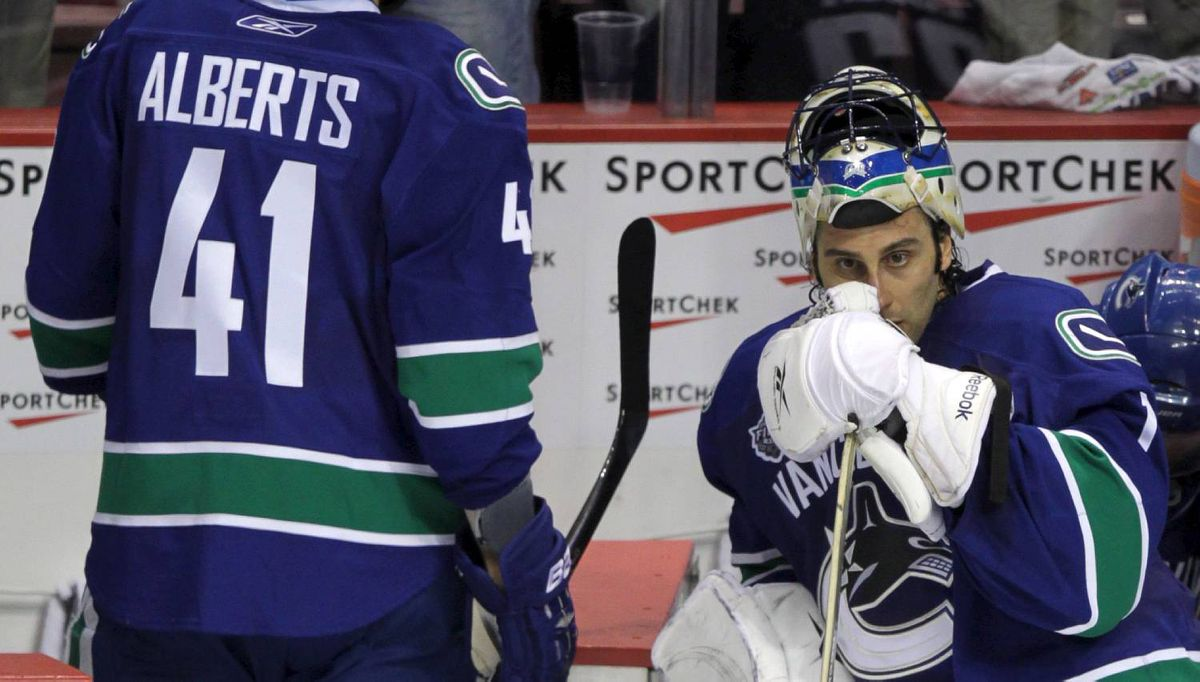 A dejected Vancouver Canucks goalie Roberto Luongo and Vancouver Canucks Andrew Alberts after losing to the Boston Bruins in game seven of the Stanley Cup final in Vancouver June 15, 2011. (John Lehmann/The Globe and Mail)