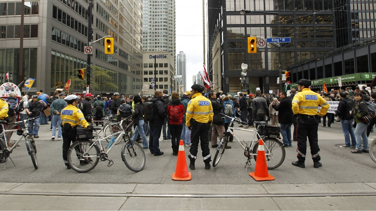 Toronto police keep an eye on protesters during the Occupy protests on October 15, 2011.