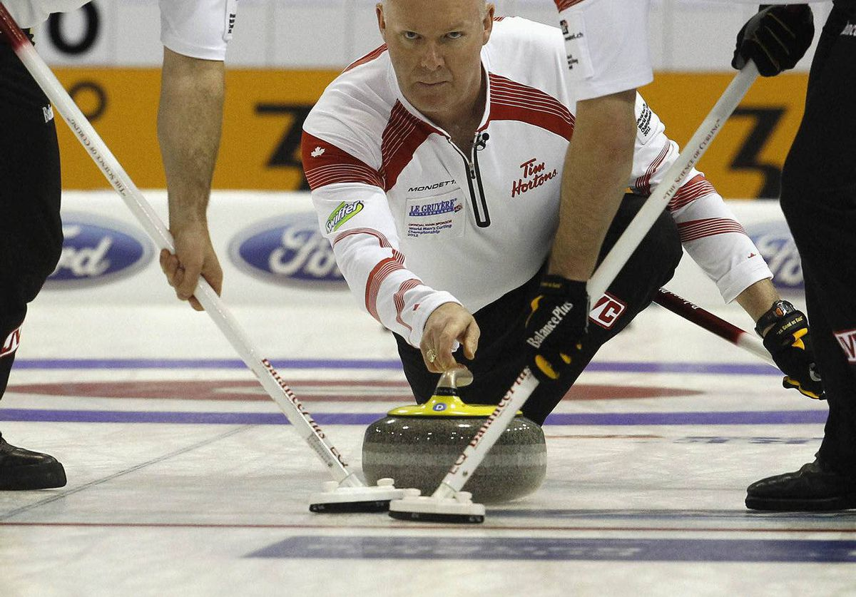 Canada skip Glenn Howard delivers his stone during play against Switzerland at the World Men's Curling Championship 2012 in Basel, Switzerland.