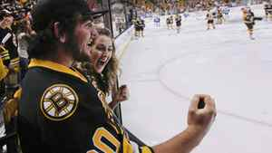 Boston Bruins fans cheer as the teams skate out onto the ice before Game 3 of the NHL hockey Stanley Cup Finals between the Vancouver Canucks and the Boston Bruins, Monday, June 6, 2011, in Boston. (AP Photo/Elise Amendola)