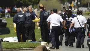 Oakland Police cover bodies near Oikos University in Oakland, Calif., Monday, April 2, 2012.