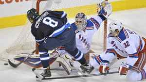 New York Rangers goaltender Henrik Lundqvist makes a save on the Winnipeg Jets Alexander Burmistrov in Winnipeg, March 28, 2012.