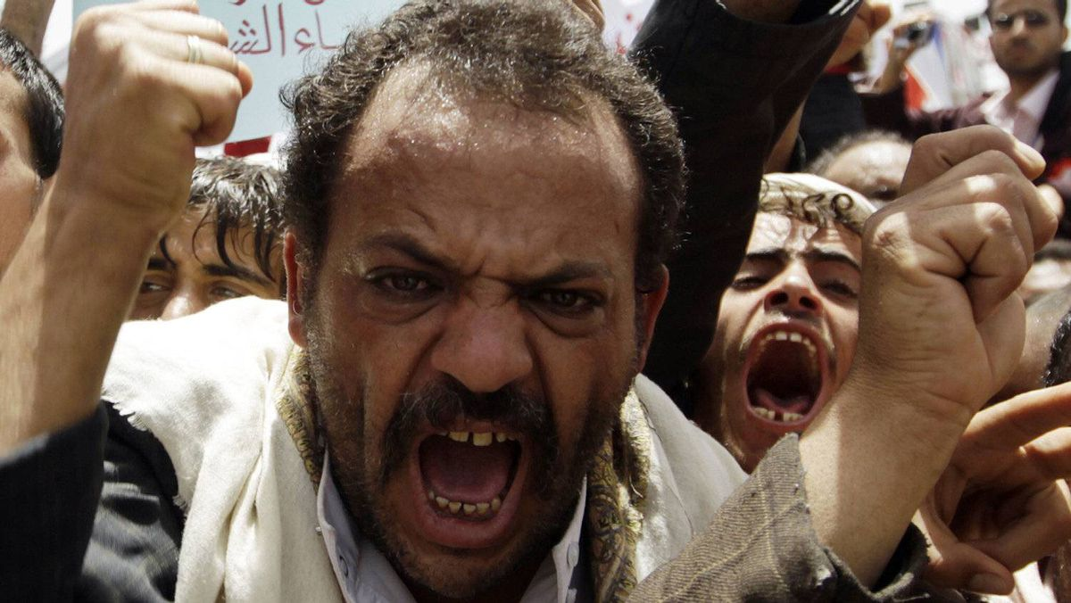 Anti-government protesters shout slogans during a rally to demand the ouster of Yemen's President Ali Abdullah Saleh outside Sanaa University Thursday.