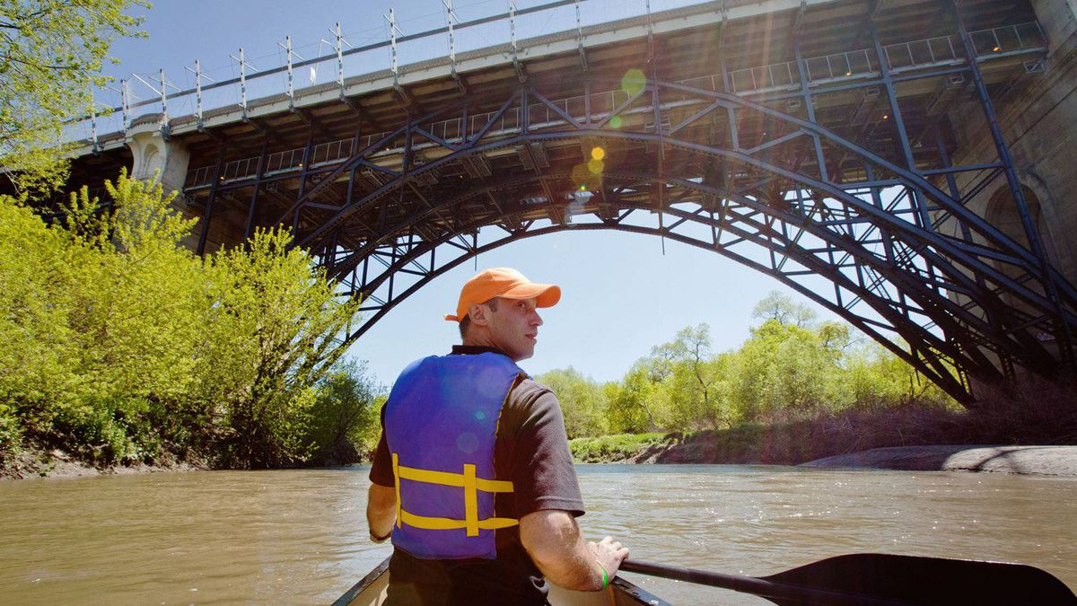 Matthew Perlanski approaches the Bloor Street Viaduct while canoeing down the Don River during the Paddle the Don event on May 6, 2012.