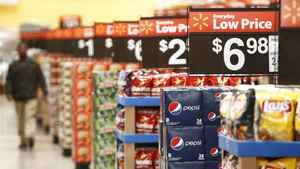 "A worker walks through the ""Action Alley"" at a new Wal-Mart store in Chicago, in this January 24, 2012 file photo."