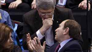 Canadian Prime Minister Stephen Harper (L) talks with NHL Commissioner Gary Bettman during the NHL All-Star hockey game in Ottawa January 29, 2012. REUTERS/Chris Wattie