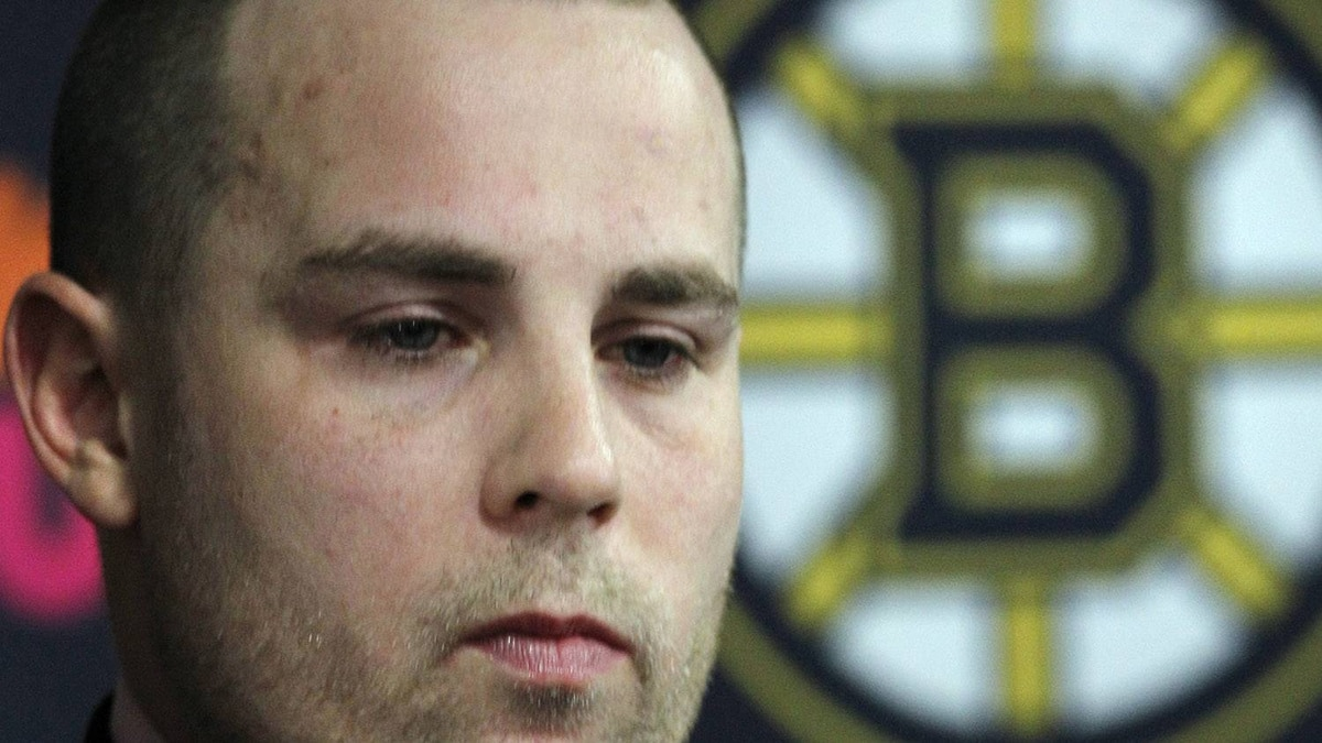 Boston Bruins forward Marc Savard reacts during a news conference, Monday, Feb. 7, 2011, in Boston where it was announced that he has been placed on long-term injured reserve and will miss the remainder of the 2010-11 NHL season. Savard sustained a concussion during a hockey game against the Colorado Avalanche on Jan. 22, his second concussion in 10 months. (AP Photo/Elise Amendola)