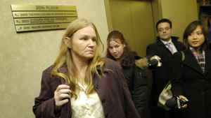 Brenda Waudby leaves an inquiry hearing in Toronto in 2007.