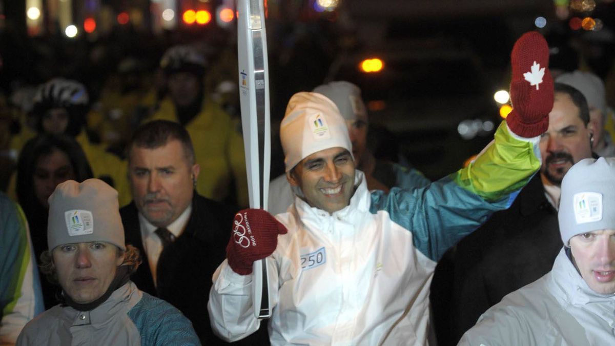 Akshay Kumar carries the Olympic Torch down Yonge Street in downtown Toronto in December. Fred Lum/The Globe and Mail