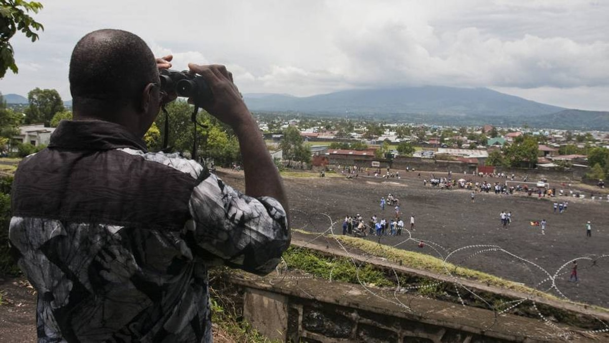 Modest Etoy of the Goma Volcano Observatory watches the active Mount Nyiragongo volcano in Goma, Democratic Republic of the Congo.
